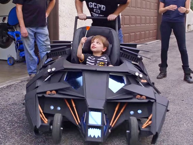 Wait, this kid gets a Batmobile stroller AND a lollipop?  Oh, you go to hell kid.  You go straight to hell.