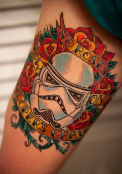 red-flowers-and-geek-soldier-tattoo-on-arm