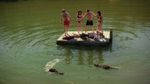 "This image comes from a movie called ""Zombeavers"".  I am not making that up.  If I know my horror movies, the dog and the woman who keeps her top on longest will be the survivors."