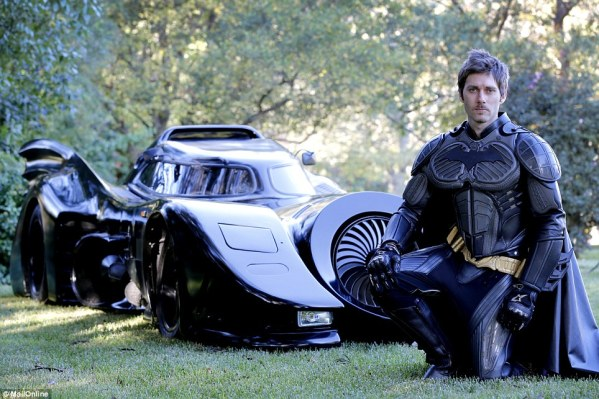 I dunno who this guy is, but he built his own roadworthy Batmobile and that is awesome!