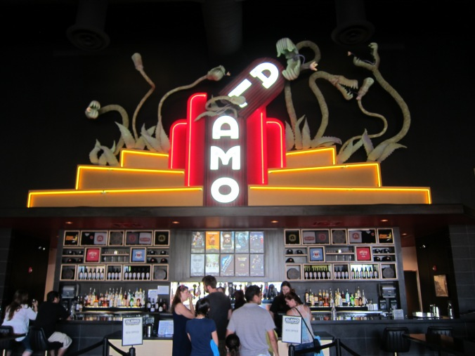 This is the Alamo Drafthouse, the greatest movie theater in the world. Especially this exact one just a few miles from Ryan's house.