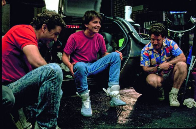 Michael J Fox working with the self-lacing shoes.  Which only require a team of two people to self-lace.